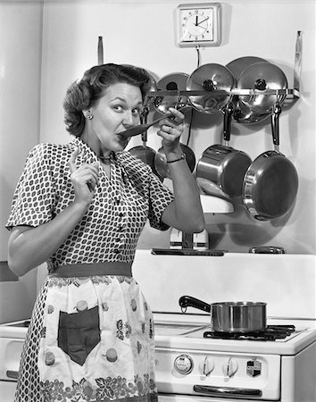 """A lady tries out one of Cannatown's new forms of liquid-volume measurements, the """"swig"""""""